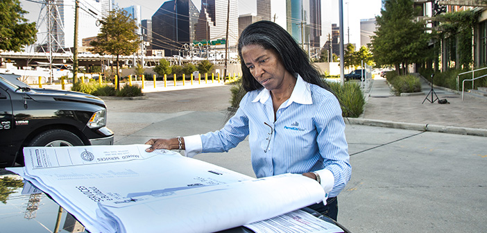 Helen Callier reviewing permitting plans